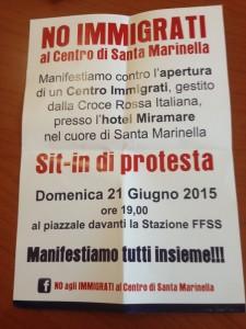 La locandina del sit-in contro il trasferimento dei migranti all'Hotel Miramare che circola per Santa Marinella